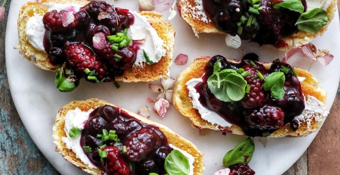 Smashed Berry Crostini with Cinnamon Labneh and Fresh Chives